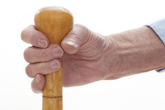 Symbol of old age , hand holding a cane Royalty Free Stock Photography