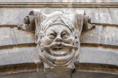 The symbol of the old antique statue with the face of a deity on a wall of the house on one of the streets of Lviv Stock Images