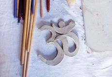 Symbol OM with clay on the desk. Stock Photography