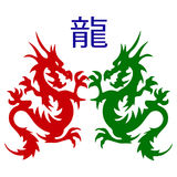 Symbol Pair of dragons silhouette, on white background. Royalty Free Stock Images