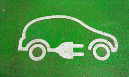 Symbol on the pavement of an electric car charging. Station Stock Image