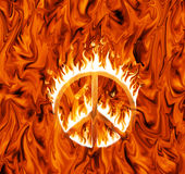 Symbol of peace engulfed in flames. On infernal background Stock Photo