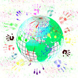 Symbol of peace and equality. Picture of the earth with the handprints Royalty Free Stock Photography