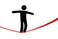Symbol person walks danger tightrope. A symbol person balances and walks a high wire tightrope, above risk and danger Royalty Free Stock Image