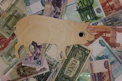 Symbol 2019 pig walks on banknotes of different countries royalty free stock image