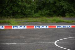 The symbol of the Polish Police on the tape separating the crime scene royalty free stock images