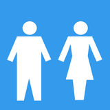 Symbol of a public toilet. Isolated on blue background Royalty Free Stock Photo