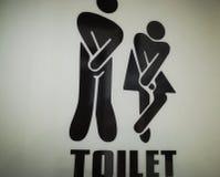 Public bathroom. Symbol of a public toilet Stock Photos