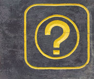 Symbol of question mark. Yellow symbol of question mark on wood Stock Photos