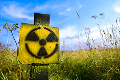 Symbol radiation. On grass background stock photography