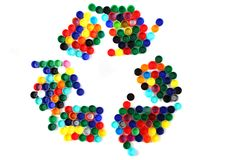 Symbol recycle from color plastic caps Stock Images