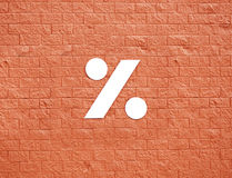 Symbol on red wall Royalty Free Stock Image