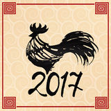Symbol 2017 rooster in the style of Chinese painting. New Year poster ink on the background of the waves. Stock Images