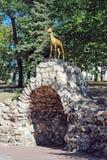 Symbol of Samara — a goat in the Strukovsky garden over a grotto. Samara. Symbol of Samara — a goat in the Strukovsky garden over a grotto. Summer day Royalty Free Stock Photos