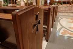 Symbol on seat in church stock image