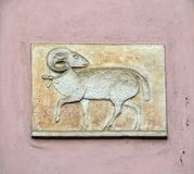 Symbol of sheep or rum on the old pink wall, Prague, Czech Republic. Prague, Czech Republic - October 10, 2017: Symbol of sheep or rum on the old pink wall royalty free stock photo