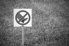 The symbol or sign means on lawns not to go Royalty Free Stock Image