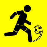 Symbol soccer. Soccer player symbol on a yellow background Royalty Free Stock Photography