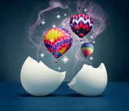 Symbol of spiritual freedom and inspiration. Balloons take off from the broken eggs. The symbol of spiritual freedom and inspiration Royalty Free Stock Photo
