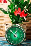 Symbol of spring green clock and blossoming flower Royalty Free Stock Images