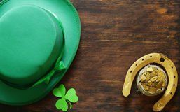 The symbol of St. Patrick`s Day is a golden horseshoe Stock Images