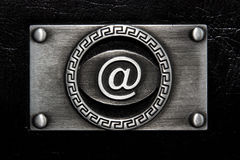 'at' symbol on the stainless plate Royalty Free Stock Photography