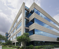 Symbol of success - modern glass office building Stock Photos