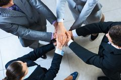 Symbol of teamwork. Team of four businessmen with folded hands, a symbol of teamwork Royalty Free Stock Photography