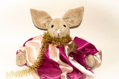 Symbol of 2019, a toy pig next to an elegant Christmas tree on a light background.  stock photos