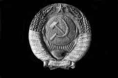Symbol of the USSR. Metal Soviet coat of arms from a railcar stock image
