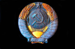 Symbol of the USSR. Metal Soviet coat of arms from a railcar royalty free stock photography
