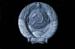 Symbol of the USSR. Metal Soviet coat of arms from a railcar stock photo