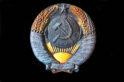 Symbol of the USSR. Metal Soviet coat of arms from a railcar stock photos