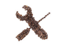Symbol of utility made with a coffee beans Royalty Free Stock Photos