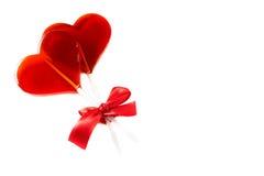Symbol Valentine's Day: lollipop associated ribbon Stock Photos