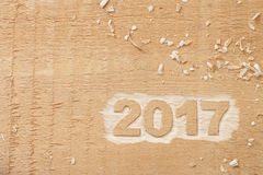 Symbol von Nr. 2017 auf hölzerner Beschaffenheit Stockfoto