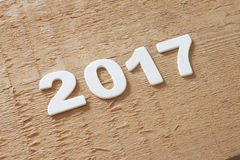 Symbol von Nr. 2017 auf hölzerner Beschaffenheit Lizenzfreie Stockbilder