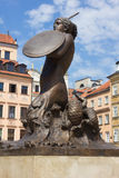 Symbol of Warsaw - mermaid over old Town colorful houses Royalty Free Stock Photo