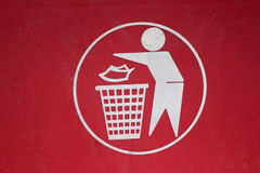 Symbol of waste disposal. Symbol of waste disposal in to a bin Royalty Free Stock Photography
