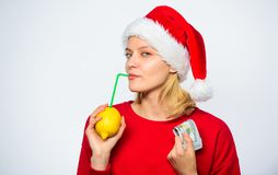 Symbol of wealth and prosperity. Christmas wishes. Rich girl with lemon and money. Woman lemon millionaire. Lemon money. Concept. Girl santa hat drink juice stock images