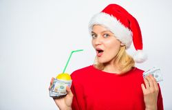 Symbol of wealth and prosperity. Source of richness. Richness symbol concept. Rich girl with lemon and money. Girl santa. Hat drink juice lemon wrapped dollar stock photo