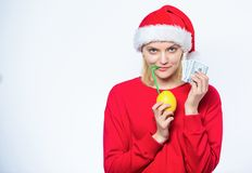 Symbol of wealth and richness. Rich girl with lemon and money. Lemon money concept. Girl santa hat drink juice lemon. While hold pile money. Make money on fresh royalty free stock photos