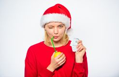 Symbol of wealth and richness. Rich girl with lemon and money. Girl santa hat drink juice lemon while hold pile money. Christmas profit concept. Lemon money royalty free stock images