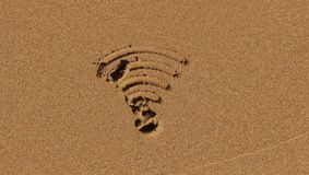 Symbol Wi-Fi i sand Arkivfoto