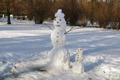 Symbol of winter: a family of snowmen in the park. Winter scenes stock images