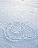 At symbol written in snow Stock Images