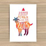 Symbol of the 2015 year, greeting card with goat. Vector watercolor background. Greeting card 2015. Happy New Year 2015. Wood text Royalty Free Stock Photography