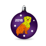Symbol of the year 2018, yellow dog sits in a Christmas ball, ca. Rtoon on a white background Royalty Free Stock Photo