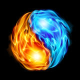 Symbol of yin and yang. Of the black background in the form of red and blue fire Royalty Free Stock Photography
