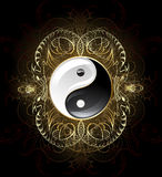 Symbol yin yang. Yin yang symbol on a dark background , decorated with gold abstract pattern of abstract beings Stock Photography